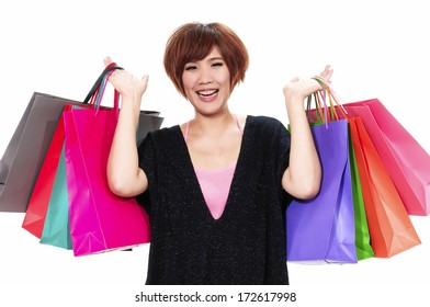 close up happy girl with shopping colorful bag