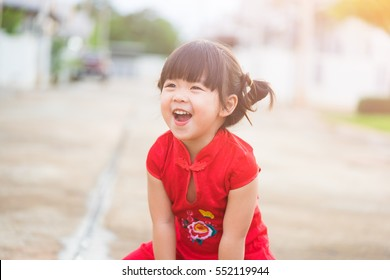 Close up Happy Little asian girl in chinese traditional dress laughing and smiling.Happy Concept.Chinese little girl happy face.happy chinese new year.