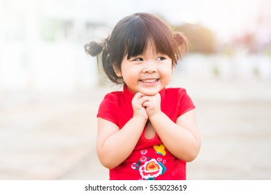 Close up Happy Little asian girl in chinese traditional dress laughing and smiling.