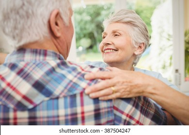 Close up of happy senior couple dancing at home