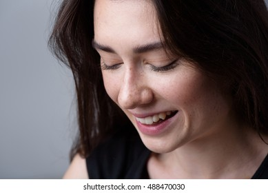 close up of a happy smiling woman with copyspace