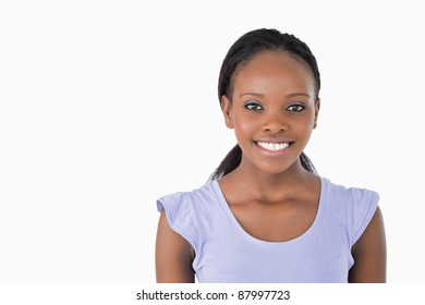 Close up of happy smiling young woman on white background