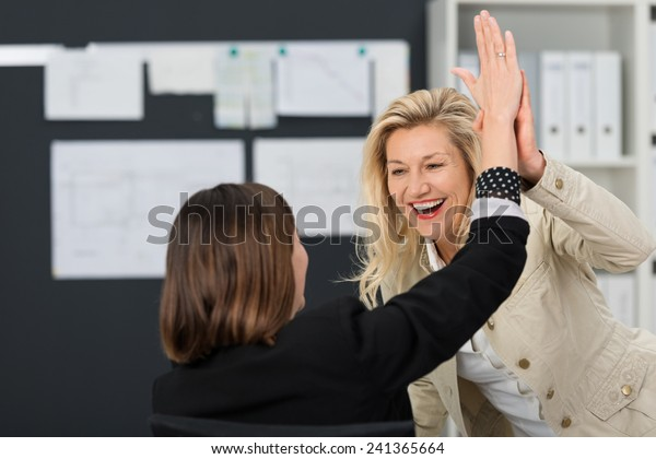 Close up Happy White Businesswoman Showing High Five Sign at the Office.