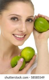Close up happy woman holding a fresh lemon