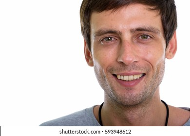 Close up of happy young handsome man smiling