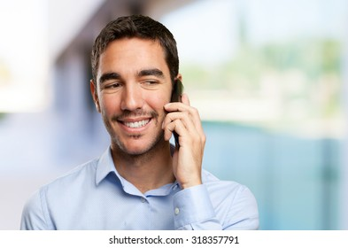 Close up of a happy young man calling on mobile phone
