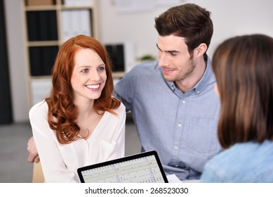 Close up Happy Young White Couple Talking to a Businesswoman with Tablet Computer About Business Projects.