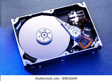 Close up of hard disk's internal mechanism hardware