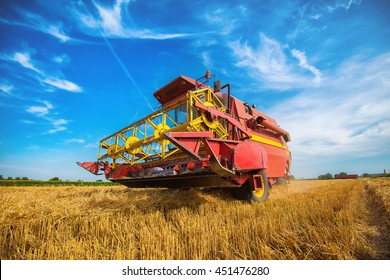 Close up of a harvester on a wheat field.