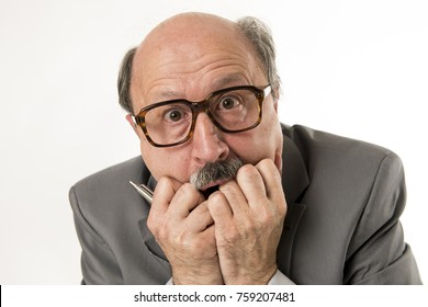 close up head portrait of bald 60s senior business man surprised and scared looking as if big mistake or disaster in the office isolated on white  background