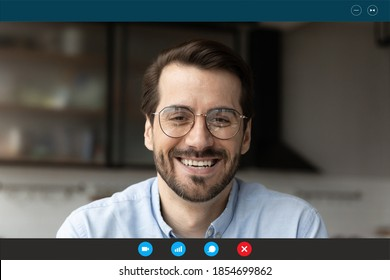 Close up head shot computer application screen view happy 30s bearded man in eyeglasses holding video call funny talk with friends, entertaining enjoying online distant communication alone at home.