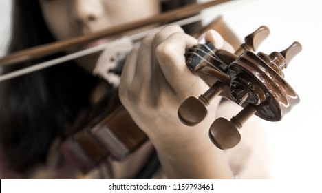 close up head of violin with asian girl play song vintage moode