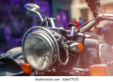 Close up of a headlight of a classic rusty motorcycle