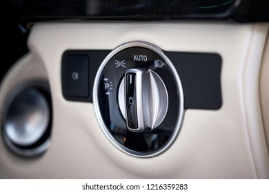 Close up of headlight controller panel in modern luxury car. The intelligent headlight control help improving vision makes driving at night safer and more comfortable without blinding other road users