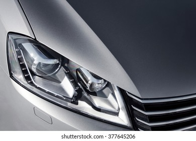 close up headlight of grey car at daytime