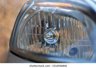 Close up of headlight or headlamp car. Selective focus