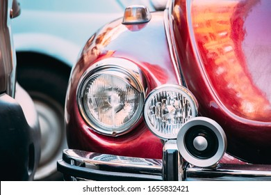 Close Up Headlight Of Old Retro Vintage Red Color Car Parked At Street