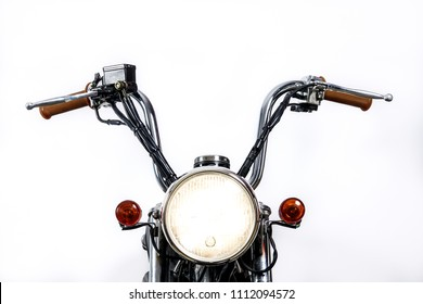 Close up of headlight on vintage motorcycle. Custom chopper / scrambler motocross. Retro motorbike on white background. Blank copy space for text.