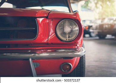Close up headlight of red Retro classic car, Vintage tone