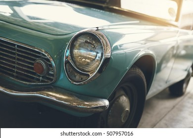 Close up of headlight Retro classic car, Vintage tone