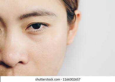 Close up headshot of adult woman with clean fresh skin isolated on white background. She open her eye.