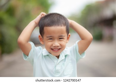 close up headshot of asian children laughing with happiness face