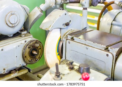 Close up headstock and grinding wheel and wheelhead of high accuracy surface cylindrical grinding machine of manufacturing finishing process for industrial