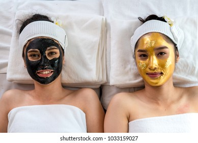 Close up of Healthy Young Women getting mud Black and gold facial mask cosmetic procedure in the beauty salon.Skin treatment in spa salon concept