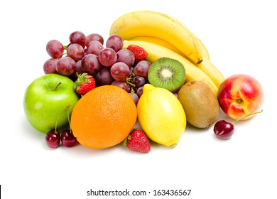 Close up of heap of fruit, isolated on white. Concept of healthy eating and dieting lifestyle