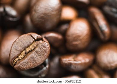 Close up heap of roasted brown coffee beans