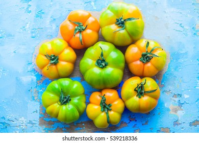 Close up of heirloom tomatoes over a blu rusty background