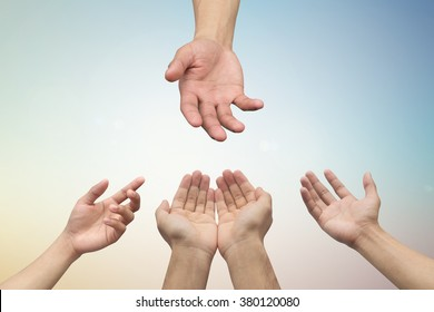 close up of helping praying hands on blurred sunrise sky background for health healing concept.