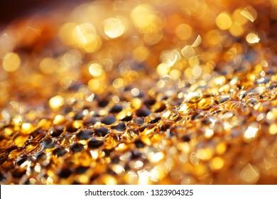 close up of hexagon texture golden bokeh bee hive background.