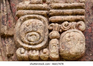Close up of hieroglyph carved into stone column at in the ancient Mayan city of Copan. Honduras, Central America.