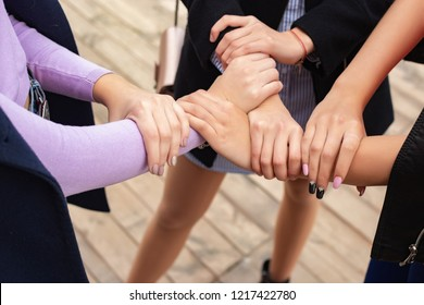 Close up of high five hand gesture, symbol of common celebration or greeting. Success and teamwork concept
