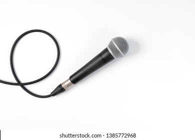 Close up of high quality dynamic microphone connect with male xlr connector and  cable isolated on white background,top view. 			High fidelity microphone on white background with clipping path .