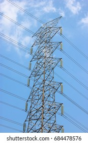 Close Up Of  High Voltage Pole With Blue Sky Background