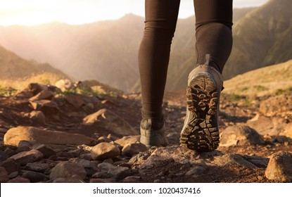 Close up of hiker boots trekking in the mountains with copy space