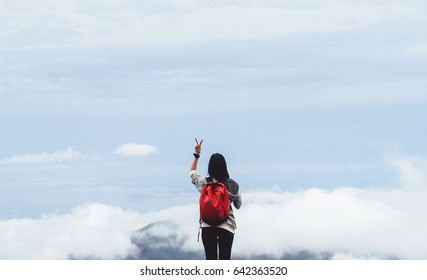 Close up Hiker woman raised her hands  fog in mountains