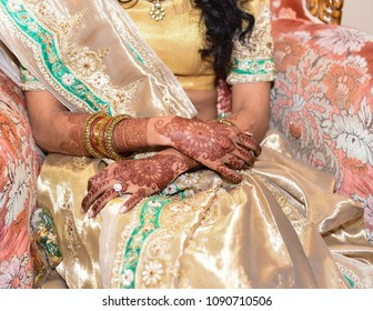 Close Up of Hindu Bride with Henna Tattoo and gold bracelets