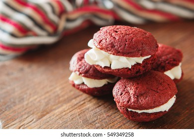 Close up of hocolate whoopie pies with vanilla cream, copy-space