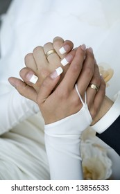 close up of holding hands bride and groom