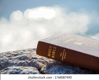 Close up holy bible on stone with bokeh