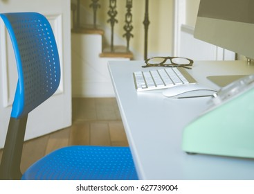 Close up of Home Office Work Station With Computer, Mouse, Keyboard and Phone