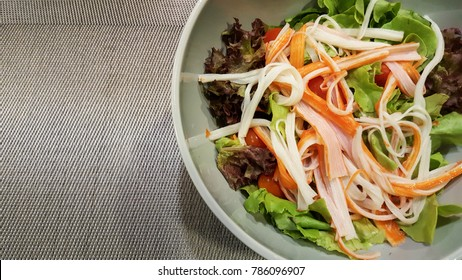 Close up of homemade salad with crab stick.
