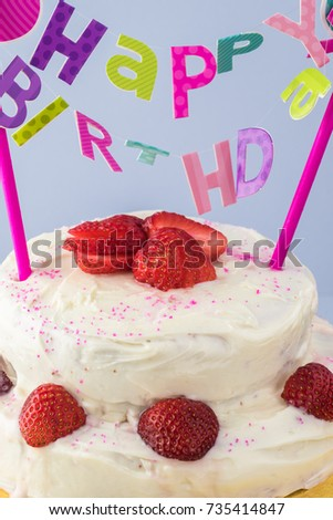 Close Up Of Homemade Strawberry Cake With Happy Birthday Banner