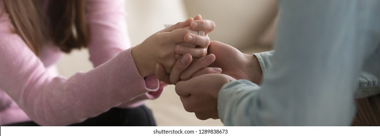 Close up horizontal photo man touch hold hands of beloved woman friend support help symbol, forgiveness apologizing gesture, psychological assistance empathy concept, banner for website header design