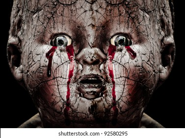 Close up Horror photo of a Cracked Scary Doll Crying Blood