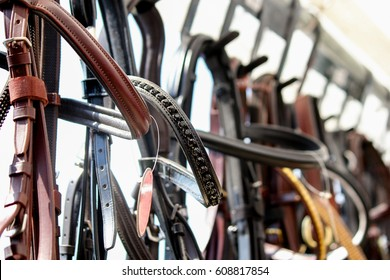 Close up of horse bridles on the display rack for sale