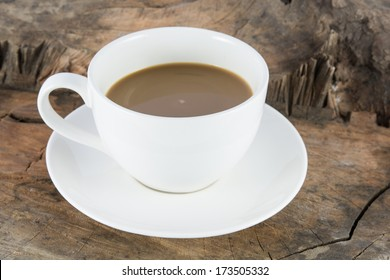 Close up hot coffee drink on wood background